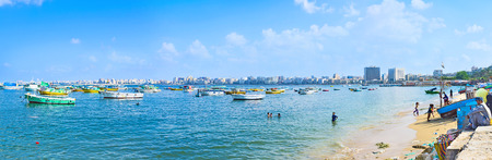 sand harbor: ALEXANDRIA, EGYPT - OCTOBER 11, 2014: Panorama of the Eastern harbor with the sand beach and numerous fishing boats, on October 11 in Alexandria. Editoriali