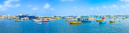 alexandria egypt: Alexandrias fishing port is the best place to enjoy colorful boats and visit the old fish market, located next to the Qaitbay Citadel, Egypt.