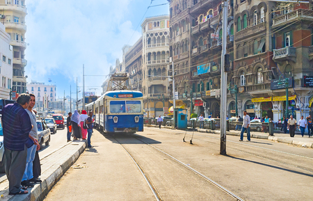 ALEXANDRIA, EGYPT - OCTOBER 11, 2014: People wait for the tram at the station, on October 11 in Alexandria.