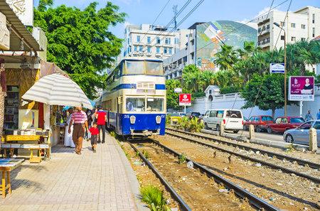 alexandria egypt: ALEXANDRIA, EGYPT - OCTOBER 11, 2014: The unusual double-deck tram is the popular tourist attraction, on October 11 in Alexandria.