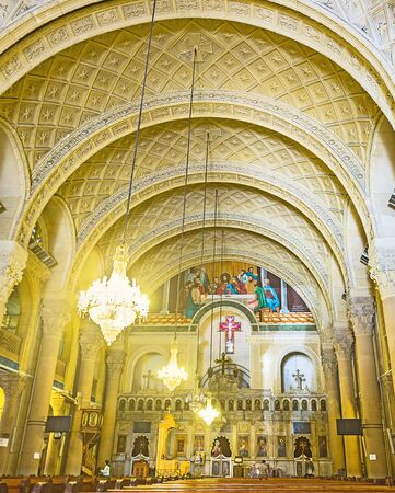 coptic orthodox: ALEXANDRIA, EGYPT - OCTOBER 11, 2014: The interior of the Coptic Cathedral of St Mark with beautiful iconostasis and many chandeliers, on October 11 in Alexandria.