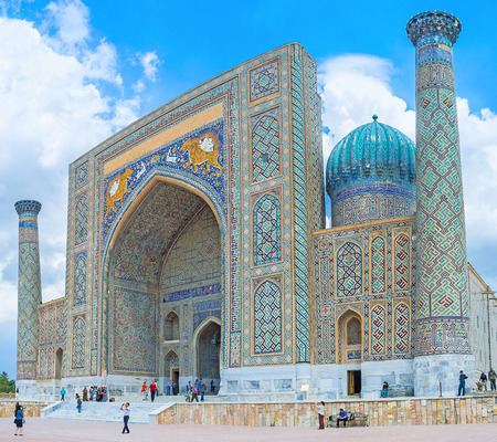 registan: SAMARKAND, UZBEKISTAN - APRIL 30, 2015: The facade of Sher-Dor Madrasah, that is famous for its beautiful tiger mosaics and located at the Registan Square, on April 30 in Samarkand.