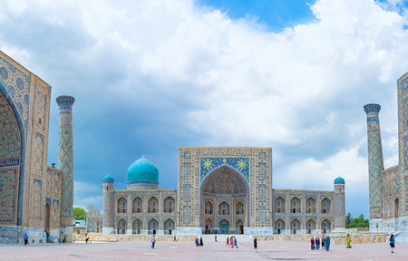 registan: SAMARKAND, UZBEKISTAN - APRIL 30, 2015: Tilya Kori Madrasah is the central object at the Registan Square, it also served as the Grand Mosque, on April 30 in Samarkand.