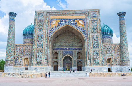 registan: SAMARKAND, UZBEKISTAN - APRIL 30, 2015: The tiger mosaics on the facade of Sher-Dor Madrasah became the symbol of the country, on April 30 in Samarkand.