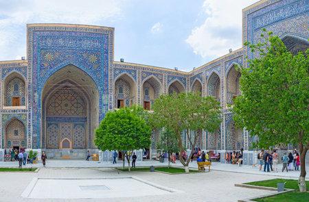 registan: SAMARKAND, UZBEKISTAN - APRIL 30, 2015: The portals in the courtyard of Ulugh Beg Madrasah boasts the beautiful mosaic decoration, on April 30 in Samarkand.