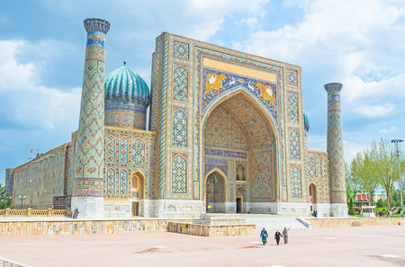 old building facade: The Registan Square is the best place to discover  the old Uzbek architecture and to enjoy the great mosaic decorations, Samarkand, Uzbekistan.