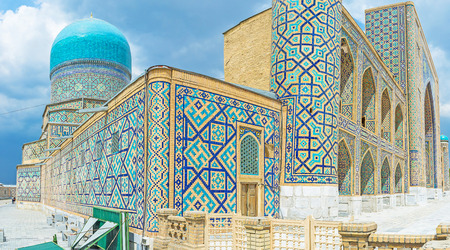 registan: The Tilya Kori Madrasah with its bright blue dome and walls, covered with the geometric traceries, made of blue tiles, Samarkand, Uzbekistan. Editorial