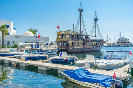 boast: MONASTIR, TUNISIA - AUGUST 29, 2015: All the resorts of Tunisia boast the beautiful wooden pirate galleons for the tourist enjoy, on August 29 in Monastir.