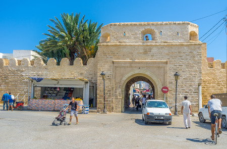 rampart: MONASTIR, TUNISIA - AUGUST 29, 2015: The The medieval arabic Medina surrounds by the huge stone rampart, on August 29 in Monastir.