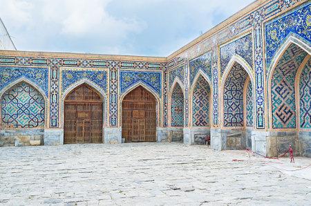 portals: The portals in the courtyard of Tilya Kori Madrasah boasts the unique mosaic ornaments, Samarkand, Uzbekistan.
