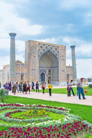 registan: SAMARKAND, UZBEKISTAN - APRIL 30, 2015: The Registan Square surrounded by colorful flower beds, on April 30 in Samarkand. Editorial