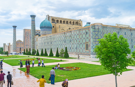 registan: SAMARKAND, UZBEKISTAN - APRIL 30, 2015: The Registan Square and its ornamental garden are the popular tourist place, on April 30 in Samarkand.