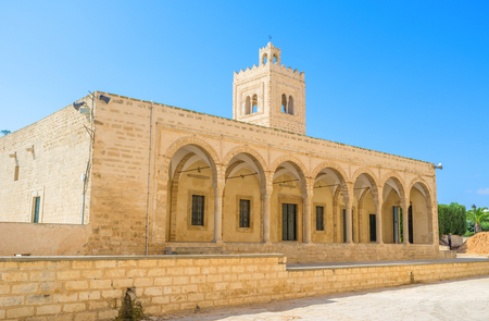 neighboring: The facade of the medieval Grand Mosque, that is neighboring with Ribat citadel, Monastir, Tunisia.