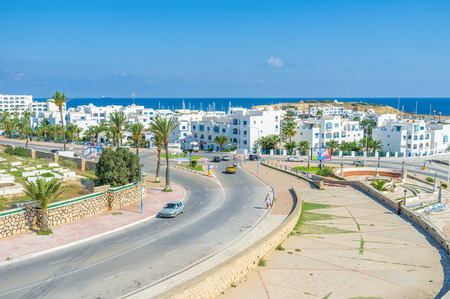 surrounds: The neighborhood of the white hotels and restaurants surrounds the small fishing port, Monastir, Tunisia. Editorial
