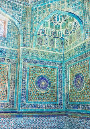 oko: SAMARKAND, UZBEKISTAN - May 1, 2015: The bright blue tiles on the walls of  mausoleum of Shodi Mulk Oko in Shah-i-Zinda architectural complex, on May 1 in Samarkand.