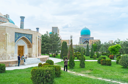 registan: SAMARKAND, UZBEKISTAN - APRIL 30, 2015: Locals enjoy the scenic garden, surrounding the Registan square, on April 30 in Samarkand. Editorial