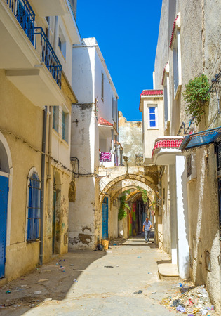 slums: BIZERTE, TUNISIA - SEPTEMBER 4, 2015: The old Bizerte is full of slums with the maze of narrow streets, on September 4 in Bizerte. Editorial