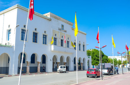 townhall: BIZERTE, TUNISIA - SEPTEMBER 4, 2015: The white building of the tonwhall located next to the old town, on September 4 in Bizerte.