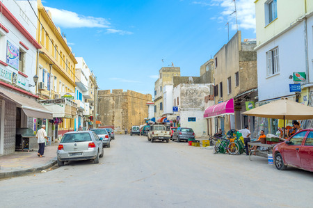 rampart: BIZERTE, TUNISIA - SEPTEMBER 4, 2015: The wide street with the numerous stalls ends with the high rampart of Kashbah, on September 4 in Bizerte.