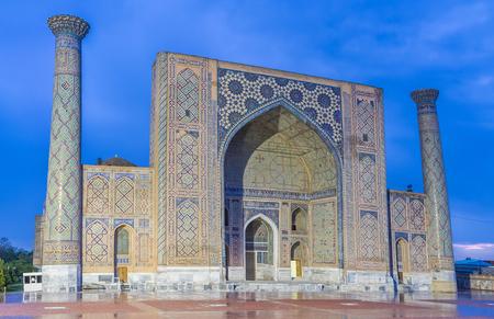 registan: The bright illumination of Ulugh Beg Madrasah on the Registan Square, Samarkand, Uzbekistan. Stock Photo