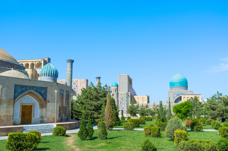 registan: The old square of Registan and Chorsu trading dome surrounded by the lush garden, Samarkand, Uzbekistan.