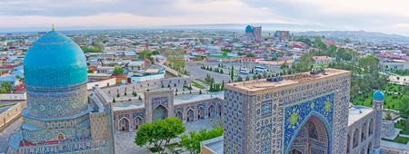 portals: The tiled domes and mosaic portals of Registan square looks great from the minaret top, Samarkand, Uzbekistan.