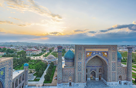 registan: One of the minarets on Registan square can be the best place to watch the sunrise, Samarkand, Uzbekistan.