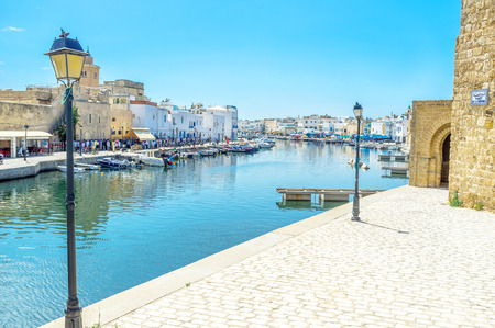 BIZERTE, TUNISIA - SEPTEMBET 4, 2015: The old port is empty in the middle of the hot day on September 4 in Bizerte. Publikacyjne
