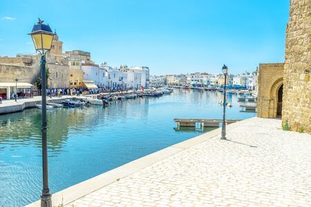 mohammedan: BIZERTE, TUNISIA - SEPTEMBET 4, 2015: The old port is empty in the middle of the hot day on September 4 in Bizerte. Editorial