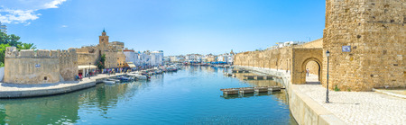 BIZERTE, TUNISIA - SEPTEMBER 4, 2015: The port of Bizerte is very long, so the old neighborhoods stretch along it from the both sides on September 4 in Bizerte. Editorial