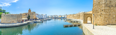 mohammedan: BIZERTE, TUNISIA - SEPTEMBER 4, 2015: The port of Bizerte is very long, so the old neighborhoods stretch along it from the both sides on September 4 in Bizerte. Editorial