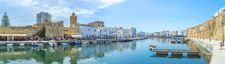 mohammedan: BIZERTE, TUNISIA - SEPTEMBER 4, 2015: The friday morning is the time for Mohammedan prayer, so the muslims praing in the mosque and outside it, on September 4 in Bizerte. Editorial