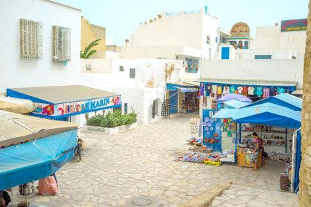 slums: HAMMAMET, TUNISIA - SEPTEMBER 6, 2015: The tourist market located next to the Kashbah walls, on September 6 in Hammamet.