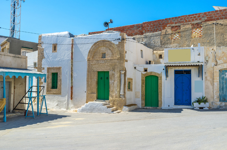 tine: The tine square of the old town with many colorful wooden doors, Mahdia, Tunisia. Stock Photo