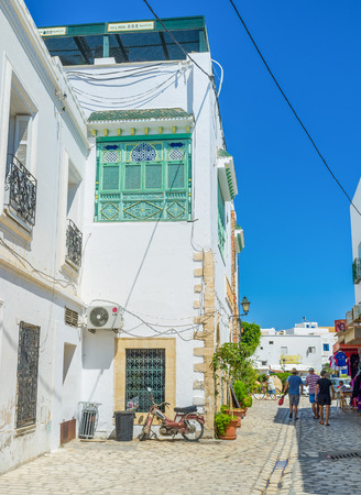 arabic architecture: MAHDIA, TUNISIA - AUGUST 29, 2015: The streets of Medina are the best place for the lazy walk, enjoing the old arabic architecture, on August 29 in Mahdia