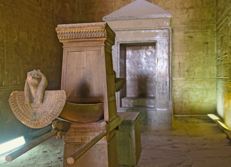 cult: EDFU, EGYPT - OCTOBER 7, 2014: The sanctuary contains the oldest object in the Horus temple, a granite naos shrine with the cult statue, on October 7 in Edfu.