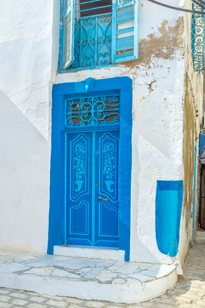 repel: According to the local believes the blue color of doors and windows can repel mosquitoes, Sousse, Tunisia.