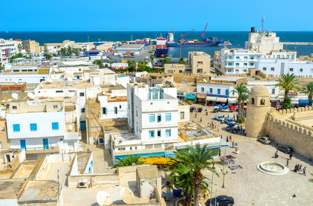 mohammedan: SOUSSE, TUNISIA - AUGUST 28, 2015: The architecture ensamble of Place des Martires that is the central square, on August 28 in Sousse.
