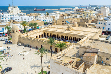 The aerial view of the Place des Martires with the numerous muslims in Grand Mosque during Mohammedan prayer, Sousse, Tunisia