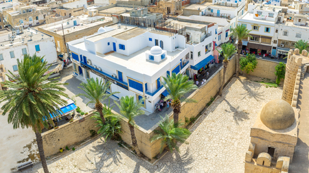 mohammedan: SOUSSE, TUNISIA - AUGUST 28, 2015: Aerial view of the old walls surrounding Ribat fortress and residential neighborhood, on August 28 in Sousse. Editorial