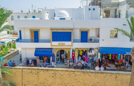 souq: SOUSSE, TUNISIA - AUGUST 28, 2015: The Ribat citadel surrounded by large market, on August 28 in Sousse. Editorial