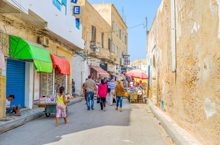 rue: SOUSSE, TUNISIA - AUGUST 28, 2015: Rue de France is the popular tourist street, that naighbors with the old rampart, on August 28 in Sousse. Editorial