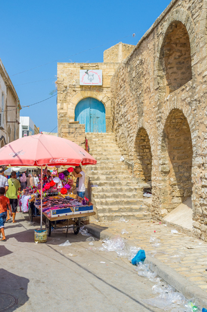 souq: SOUSSE, TUNISIA - AUGUST 28, 2015: The old town in Tunisia is named Medina and offen its surrounded by the huge rampart, on August 28 in Sousse.
