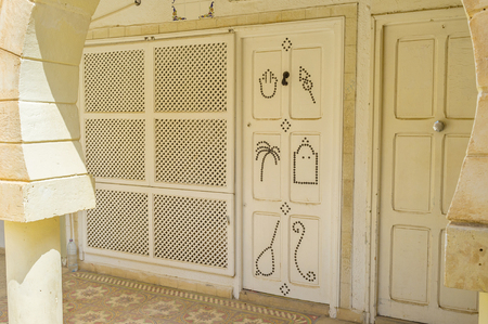 rivets: The wooden door decorated with patterns made of rivets, Sousse, Tunisia. Stock Photo