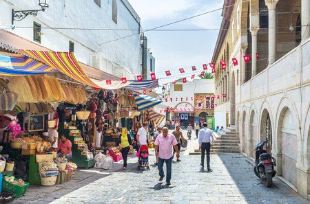 september 2: TUNIS, TUNISIA - SEPTEMBER 2, 2015: The old market neighbors with the Great Mosque, on September 2 in Tunis.