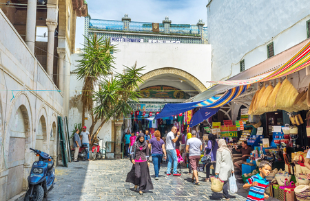 TUNIS, TUNISIA - SEPTEMBER 2, 2015: Many defferent stalls with the local goods next to the walls of the Grat Mosque, on September 2 in Tunis.