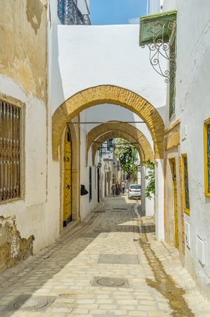 september 2: TUNIS, TUNISIA - SEPTEMBER 2, 2015: The capital of Tunisia boasts well preserved arabic town, on September 2 in Tunis.