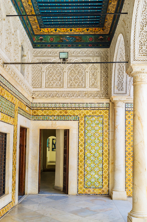 interrior: TUNIS, TUNISIA - SEPTEMBER 2, 2015: The interrior of chamber in Dar Lasram mansion with the carved wooden ceiling and colorful walls, on September 2 in Tunis.