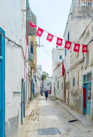 september 2: TUNIS, TUNISIA - SEPTEMBER 2, 2015: Even old and narrow streets of Medina become festive with beautiful decorations, on September 2 in Tunis.