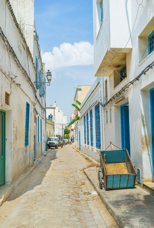 september 2: TUNIS, TUNISIA - SEPTEMBER 2, 2015: Medina of Tunis is the madieval maze of the narrow streets and alleys with old houses and scenic mantions, on September 2 in Tunis. Editorial